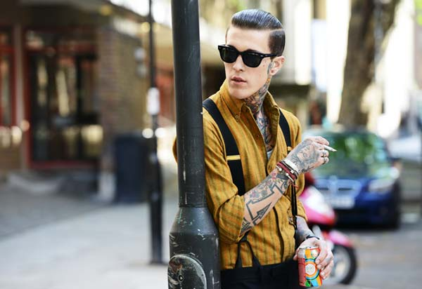 Braces Suspenders are very cool - guy with shirt braces and tattoos