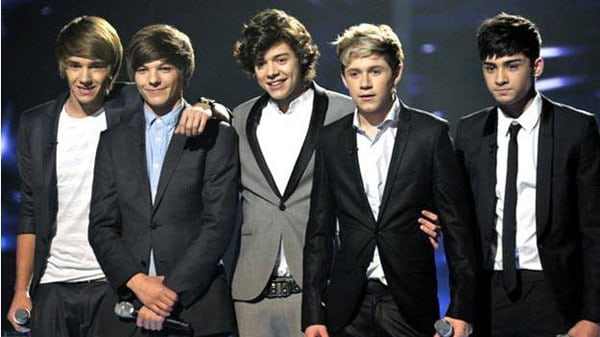 one-direction-on-stage-during-beetles-week,wearing-blazers