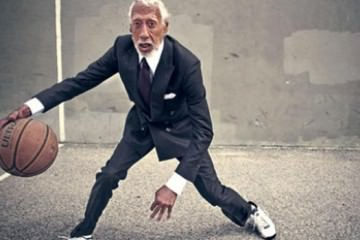 Asian guy playing basketball in a grey suit